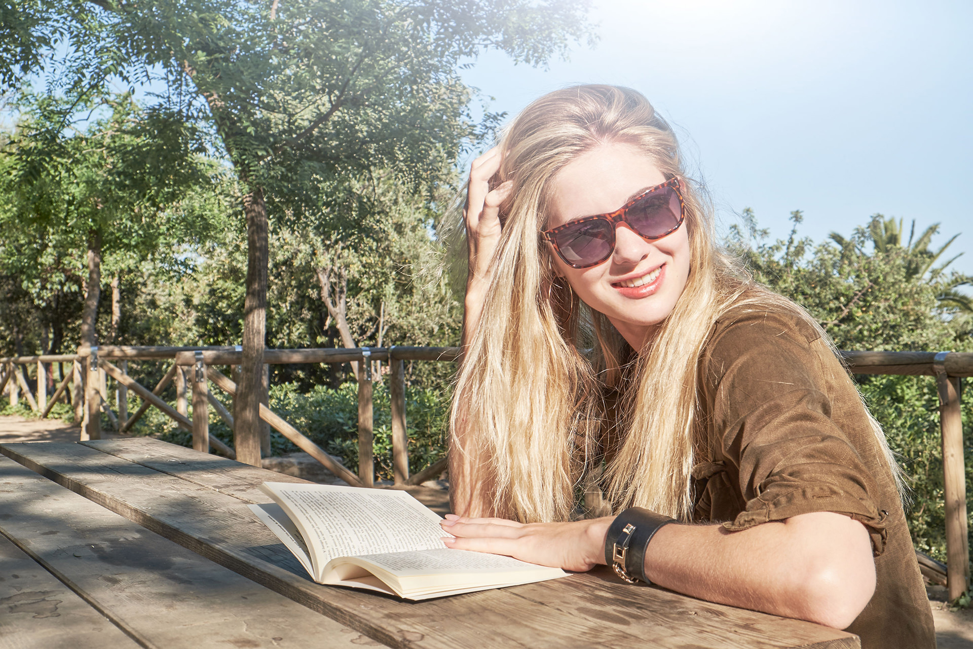 woman reading a book in Park Guell, Barcelona