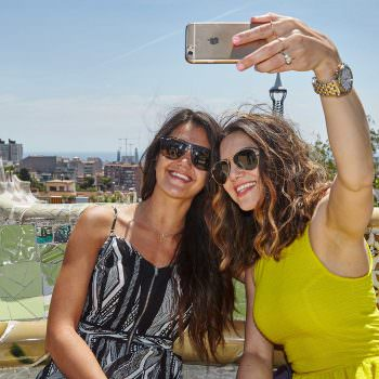 Lifestyle images of friends visiting Park Guell in Barcelona